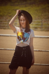 Girl with a cowboy hat and a guns and roses t-shirt