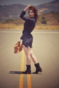 Girl on the road with a hat