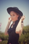 Girl with a black hat and a polka dot dress