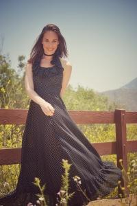 Woman in a black polka dot dress