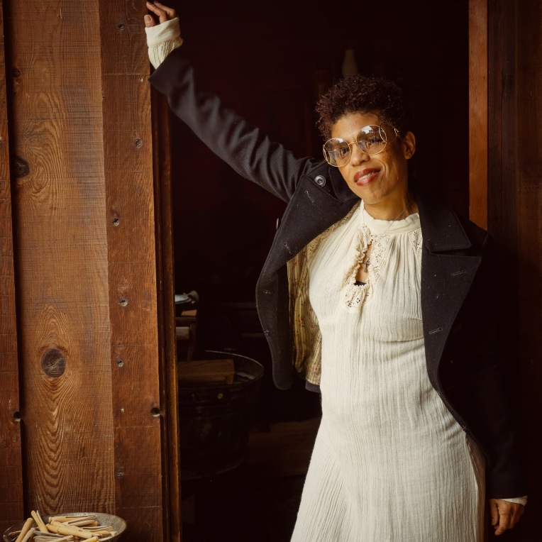 Model leaning on the door post wearing Chloe sunglasses at the stagecoach inn in Newbury Park ca