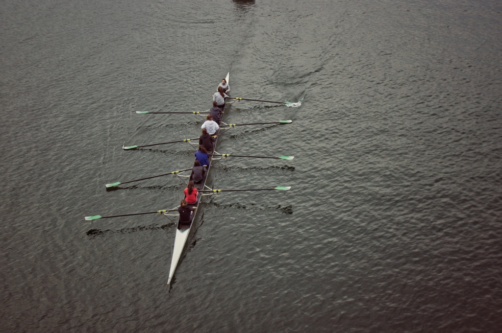 Rowing team on a river.