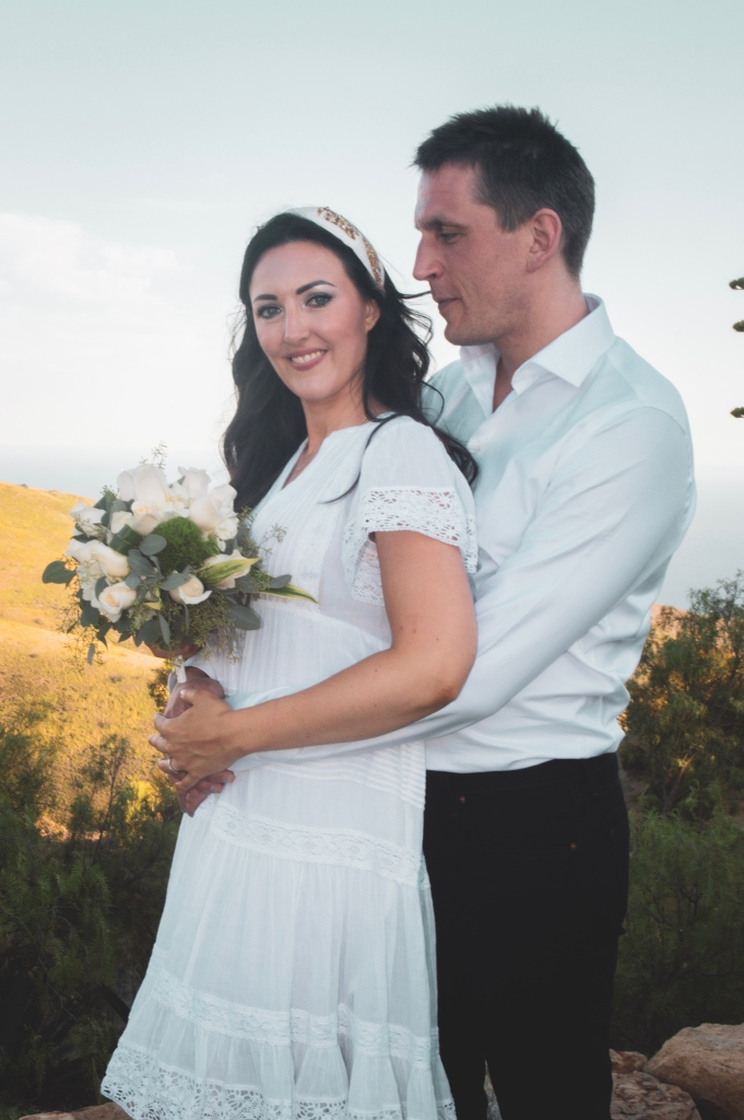 Elopement couple with white rose bouquet