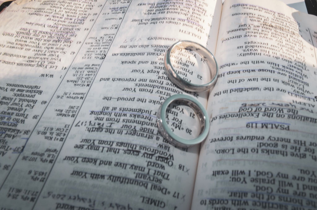 Wedding bands on a bible opened to psalm 119