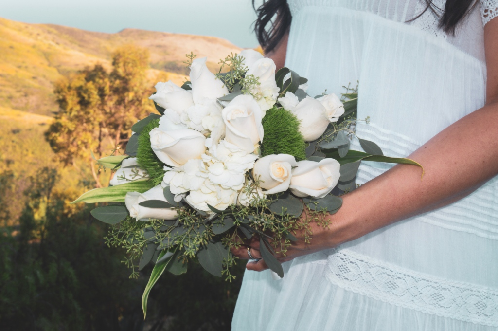 Bride holding white flower bouquet