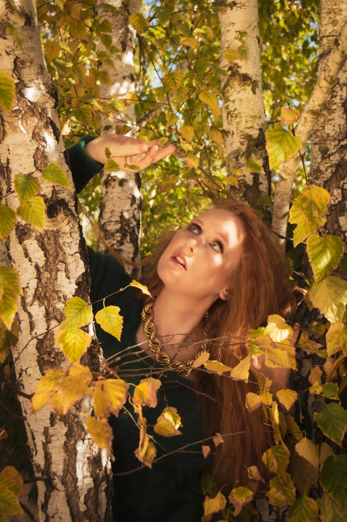 Portrait of a redhead in surrounded by fall leaves